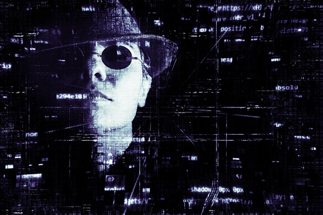 hacker with hat and sun glasses. Matrix style with code on the page.